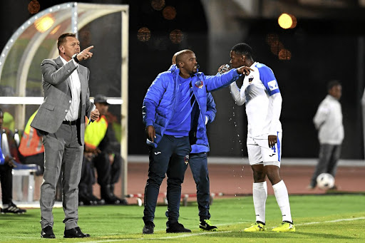 Chippa assistant coach Vincent Kobola issues instructions to Zitha Macheke .