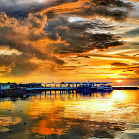 Sunset over ferry by Joey Tomas - Instagram & Mobile Android ( cloud formations, ferry docks, sunset, clouds and sea, seascape )