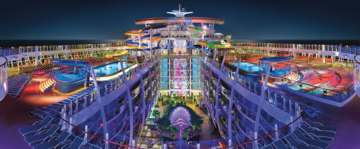 A view of the colorful top deck at night aboard Harmony of the Seas.
