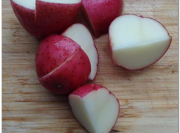 Wash and cut potatoes in half, place in boiling water, boil for 15mins, Drain.