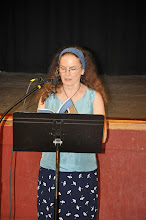 Photo: Carolyne Wright reads one of her poems.
