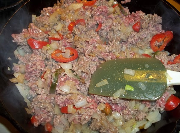 In a large skillet with a tbsp of oil; saute onions and jalapeno's on...