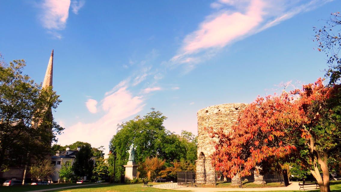 Another view of Touro Park with the Newport Tower, Channing Statue, and Channing Memorial Church.
