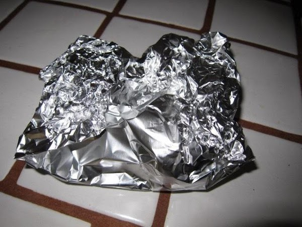 Place the tin pocket into an oven safe dish (in case of leaks). Roast...