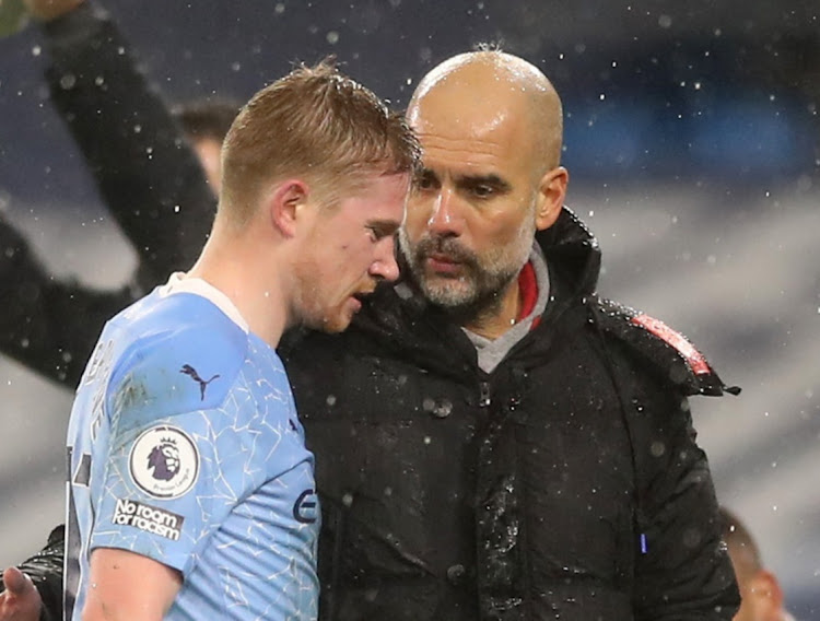 Manchester City's Kevin De Bruyne with Manchester City manager Pep Guardiola after being substituted against Aston Villa at Etihad Stadium, Manchester on January 20, 2021