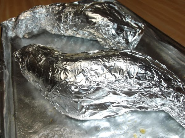 Scrub sweet potatoes well; wrap with aluminum foil; place on baking sheet.