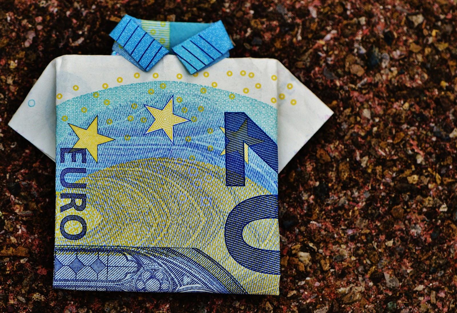 a Twenty Euro bill design polo shirt with pebbles as background.