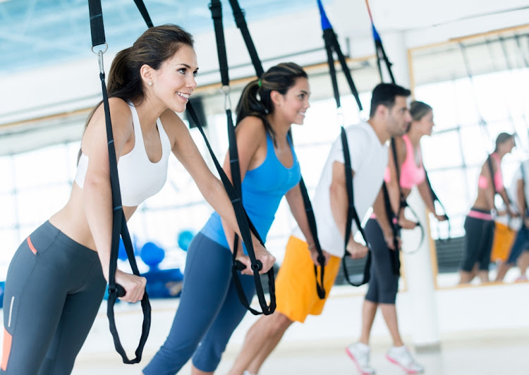 Participating in CrossFit activities as a group can help keep you motivated.