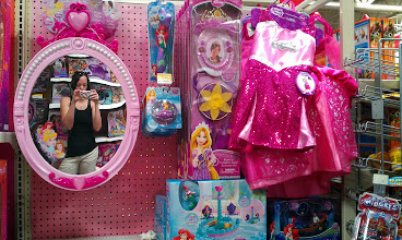 Photo: I spy some dress up clothes! Mirror mirror on the wall, shich is the best toy of all!
