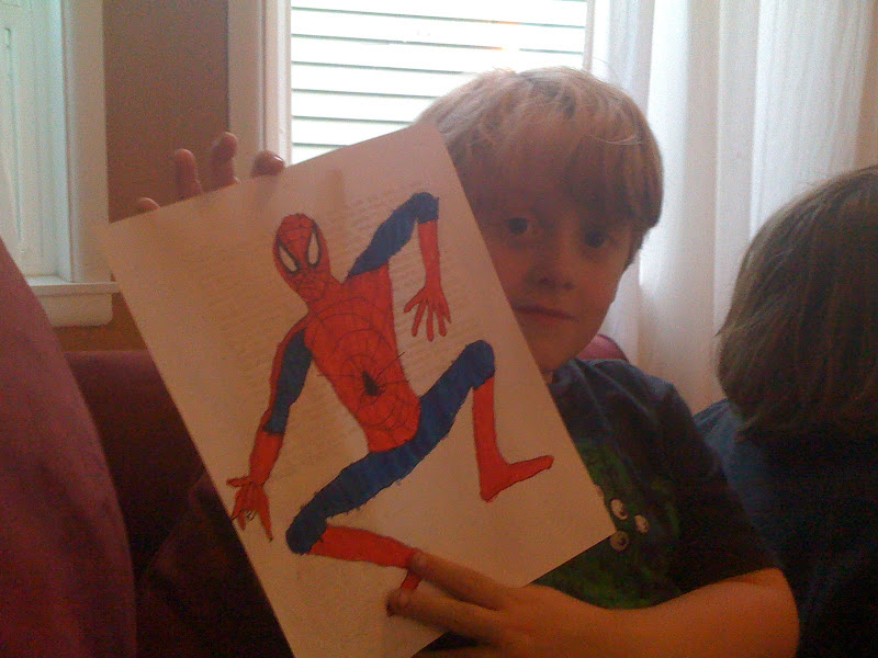 Photo: Charlie shows off his ink and color job on my rough Spider-Man sketch.