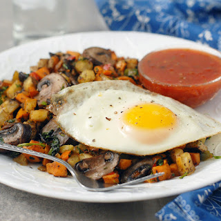 Two Potato Hash with Mushrooms and Fried Eggs.