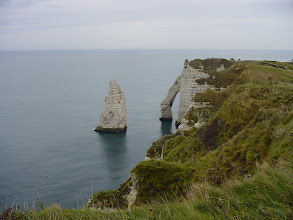 Photo: We walk up the cliff heights along to the Falaise d'Aval, where the Manneporte arch and the Aiguille (Needle) can be seen. To get a sense of the scale, this solitary spire is about 230 feet tall.