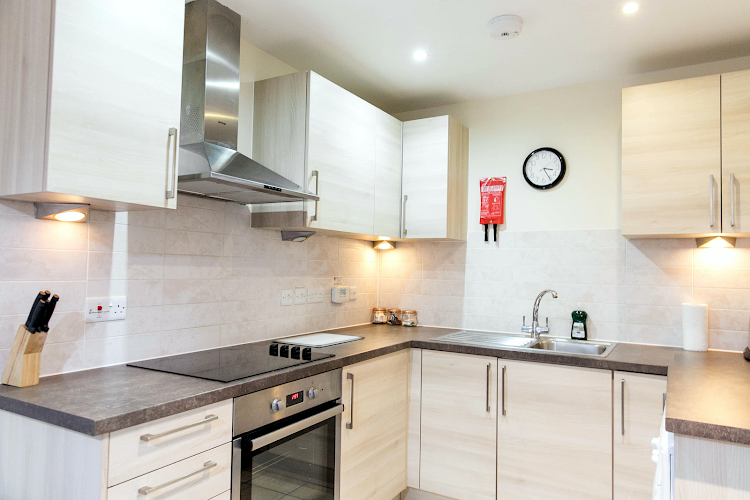 Fully equipped kitchen at Grove Cross Road Apartments