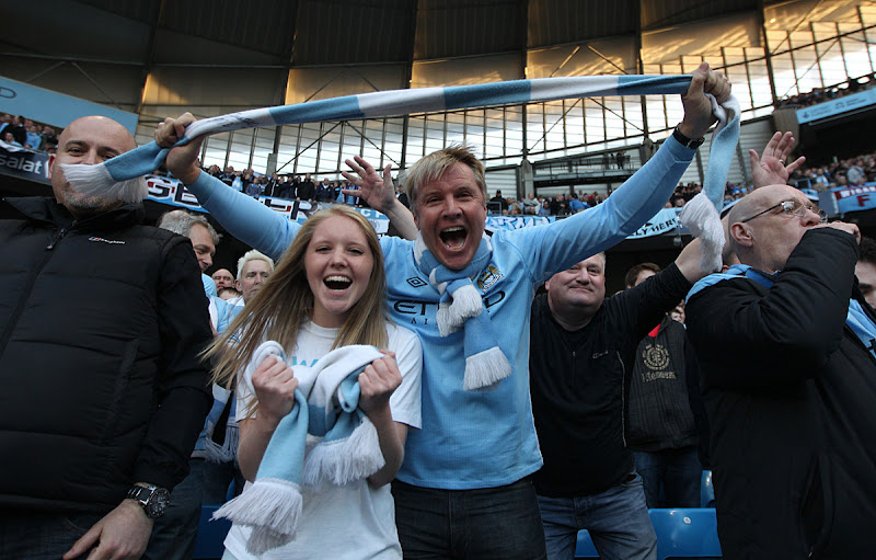 Photo: Manchester City fans celebrate in the stands