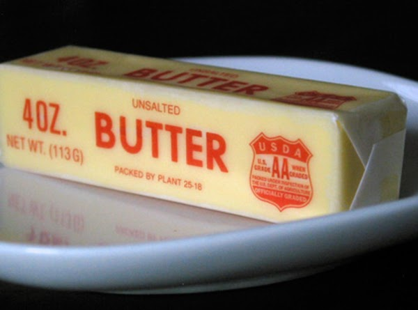 Put 1/2 a cube of butter cut in pieces under the Skin of the...