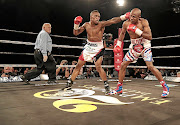 Michael Mokoena takes some punches from  Lusanda Komanisi before knocking him out last year. / Nick Lourens