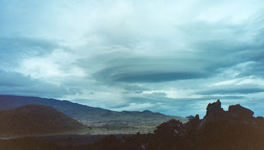 Photo: Lenticular cloud from the Saddle Rd between Maunas Kea and Loa.  It lasted at least 15 minutes but we lost sight of it as we drove along.  The blueness is courtesy of Costco's lacklustre photo development service (yes, this is from my old film camera).