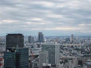 Photo: Fuji-san is hidden in the clouds behind the white tower in the center 270+ days per year