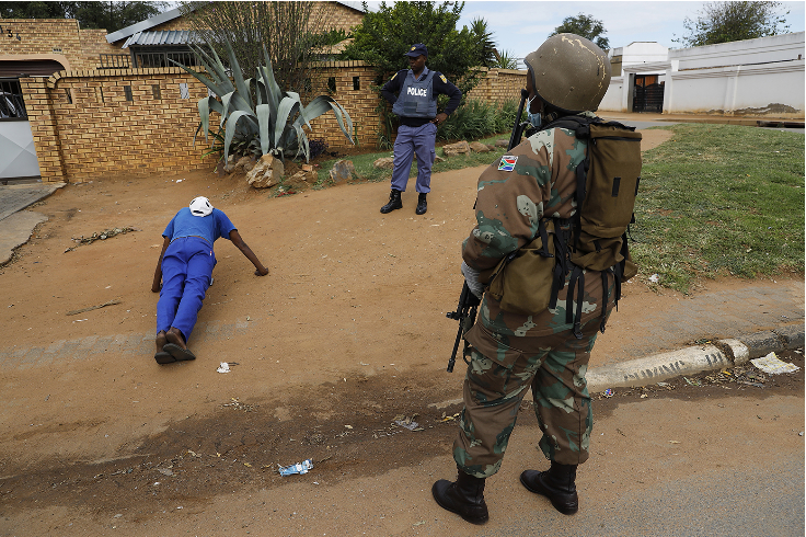 Police officers and members of the SANDF patrol the streets in Eldorado Park.