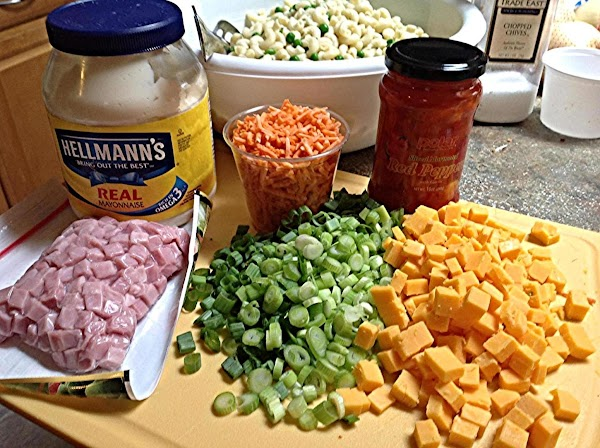 Chop the onions, cube the cheese, and chop the matchstick carrots into smaller pieces....