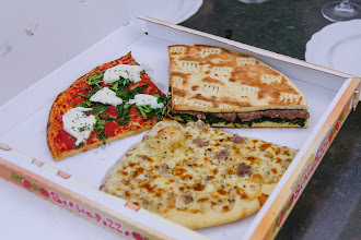Photo: Pizza slices from the Rioni 7 in the village for our dinner.  There were no other options - it is a rather small village, and we did not feel like driving.  But the pizza was really good
