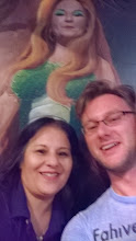 Photo: August 9-As happened a lot on the trip, I made nice with my server.  There must be a muralist who lives in Tucumcari.  Buildings were painted everywhere including the inside of the Pow-Wow.  My server was the face of this lizard woman type creature behind us.