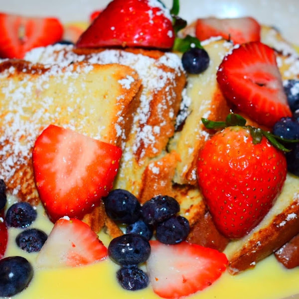 On f our special #gluten free custard French toast with delicious fresh berries