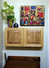 Photo: Raised-panel CD cabinet, made from spalted maple (doors) and poplar (case).  Can hang on a wall, as shown, or sit on a shelf.  Detail photos follow.