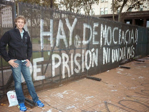 Photo: .  The photo was taken in front of the president's office in Buenos Aires, La Casa Rosada in the main plaza where many political protests and demonstrations take place.  The fence is a barricade placed in front of the President's office that has been graffitied with political rhetoric, a common sight in Buenos Aires.