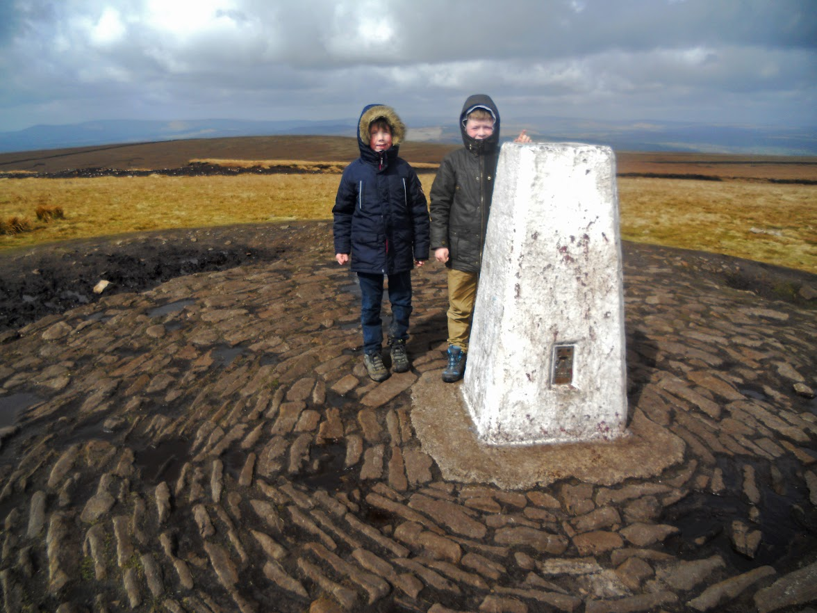 Cold and windy on the summit of Pendle Hill