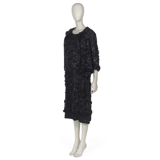 Dinner ensemble of black silk organza embroidered in black sequin lattice pattern