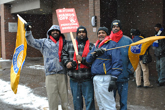 Photo: These workers pose for a photo during the march in Hamilton, Ontario.