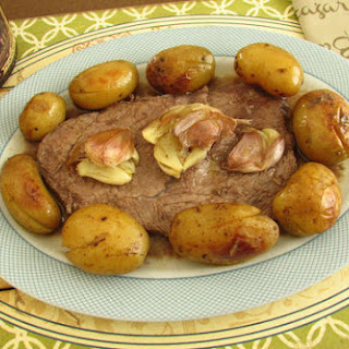 Steaks In The Oven With Unpeeled Potatoes.