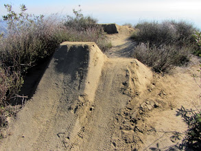 Photo: Mountain bikers put a lot of work into building these earthen ramps in several place along Upper Colby Trail.