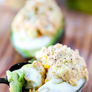 Baked Avocado & Egg with Curried Tuna Salad.