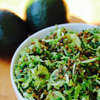 Shredded Brussel Sprout and Kale Salad with Lemon Avocado Dressing and Crispy Lentils.