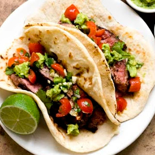 Ancho Chile and cocoa-rubbed flank steak tacos.