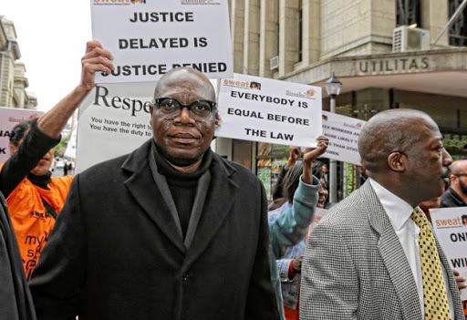 Artist and convicted murderer Zwelethu Mthethwa outside the high court in Cape Town during his court case two years ago.