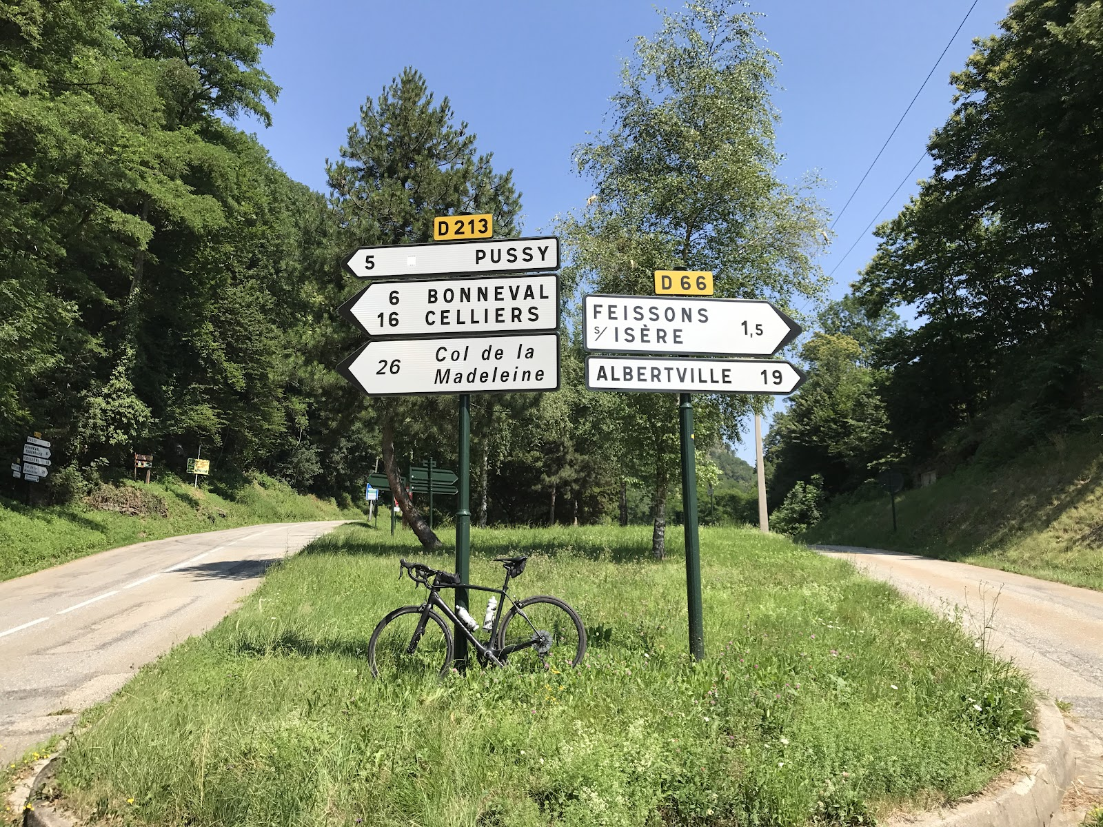 Bicycle ride of Col de Madeleine from La Léchère - start with roadway sign and bike