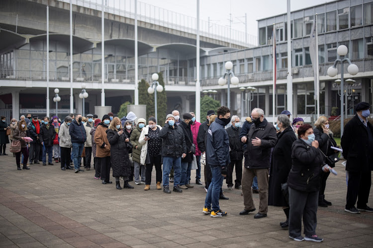 People wait in line to receive the Chinese Sinopharm vaccine as the country begins mass vaccination in Belgrade, Serbia on February 2 2021.
