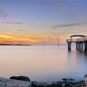 Sun of Serenity by Shaun Poston - Landscapes Sunsets & Sunrises ( shaun poston, waterscape, kenner, lake pontchartrain, sunset, louisiana, pier, long exposure, seascape )