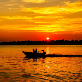 Boat by the Sun by Olga Gerik - Landscapes Sunsets & Sunrises ( silhouette, sunset, boat, #GARYFONGDRAMATICLIGHT, #WTFBOBDAVIS,  )