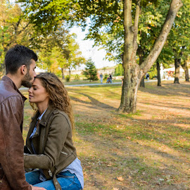 Young man kissing her girlfriends forehead by Vera Arsic - People Couples ( young women, romance, two people, friendship, heterosexual couple, city life, togetherness, young adult, kissing, model, attractive, beard, tree, lovers, lifestyles, girlfriend, enjoyment, color image, love - emotion, adult, photography, handsome, couple - relationship, city, 20-29 years, boyfriend, forehead, casual clothing, affectionate, modern, romantic, happiness, joy, grass, dating, flirting, caucasian ethnicity, public park, nature, carefree, sexy, intimate, young men, people, young couple, outdoors, bonding, feelings, fun, fashion )