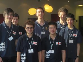 Photo: The winning 2013 Peggy Bayer team (L to R): Toby Nonnenmacher, Ben Norton, Rhys Munden, NPC Michael Byrne, Kyle Lam, Freddie Illingworth, Michael Alishaw,