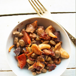 Baby Beans Sauté with Mushrooms, Bacon and Black Sausage.