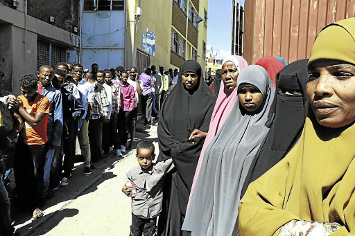 Refugees and asylum seekers queue at the refugee reception office in North End, Nelson Mandela Bay. Picture: THE HERALD