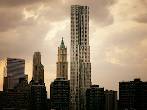 """Photo: New York Photography: New York by Gehry and the New York City skyline.  (To recap this amazing week so far:) In interesting and exciting news my photography was discussed on +Trey Ratcliff 's live on-the-air show called """"Great Google + Photographer Discoveries"""" on Monday night. To my surprise (and many other people's surprise too, I am sure), +Sergey Brin stopped by during the recording (yes, really!). I think my jaw literally dropped when he 'popped in'. I was super honored to be one of the photographers discussed but I can't even describe how it felt to hear/see my photography discussed while Sergey Brin watched. It's one of those moments I know I will cherish forever.  You can view the broadcast here at the link below. I highly recommend it if you are looking for some insanely awesome visual inspiration because the other photographers highlighted are truly phenomenal and gorgeous examples of their work are also displayed and discussed (all photographers are also linked in the link below in case you want to browse their work and circle them):  Trey's Variety Hour #20: Great Google+ Photographer Discoveries  And if that wasn't enough excitement to last for ages, I sat in as a panelist last night for a live on-the-air discussion with the one and only +Thomas Hawk and the inimitable +Lotus Carroll for their weekly video broadcast called Photo Talk Plus8. If you have ever wanted to hear me talk or see me try to not completely die of stage-fright on another great show highlighting photography (the theme last night was New York!), feel free to watch here:  https://plus.google.com/u/0/102476152658204495450/posts/UqZ2LfCnsCs  What a week, right? I have no clue how anything could top it :).    You can view this post if you wish at my site here (along with information about prints of this image):  http://nythroughthelens.com/post/16537202283/new-york-by-gehry-and-the-new-york-city-skyline    Tags: #photography #newyorkcity #nyc #architecture #manhattan #skyscrapers #"""