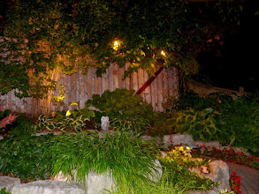 Photo: The corners of your yard are often lost but lighting can return them to prominence.