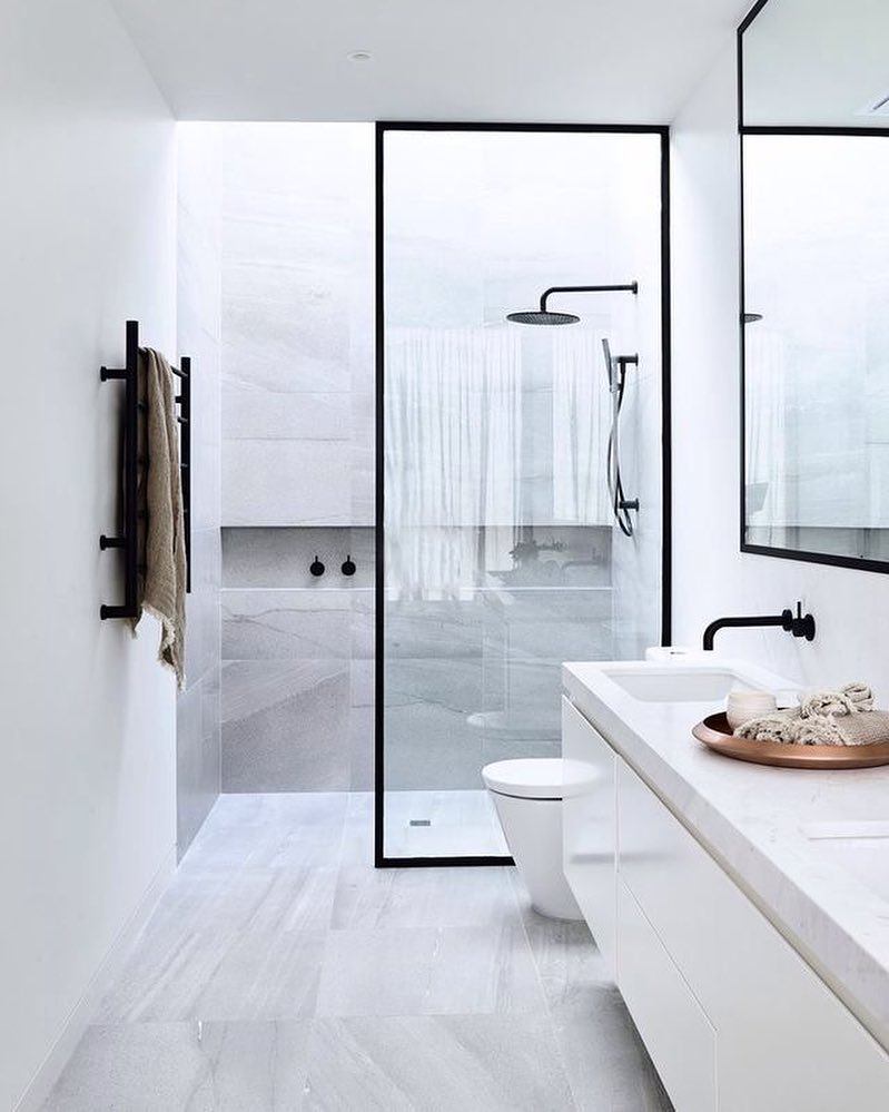 10 bathroom design ideas youd want to copy right away achieve a modern zen sanctuary by playing off the crispness of the white interiors with decorative pieces and fixtures malvernweather Choice Image