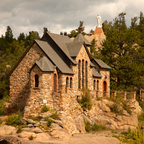 St Malo by Gayle Mittan - Buildings & Architecture Places of Worship ( country, mountains, boulder, st malo, flood damage, church, washed out, statue, clouds, colorado, arched, stone church, stone, rock, jesus, evergreens, rocks, pine trees, stones, landscape, catholic church )